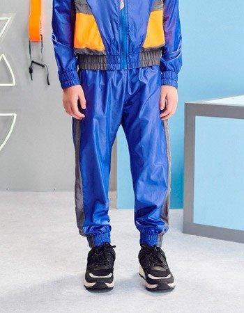 detalhe calca corta vento infantil sport azul youccie d0417